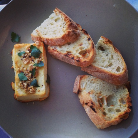 Baked feta with hazelnuts, truffle honey and grilled bread