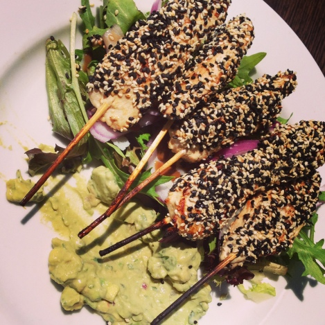 Sesame chicken skewers mixed lettuce onion tomatoes parmesan salad guacamole Sauce Coogee